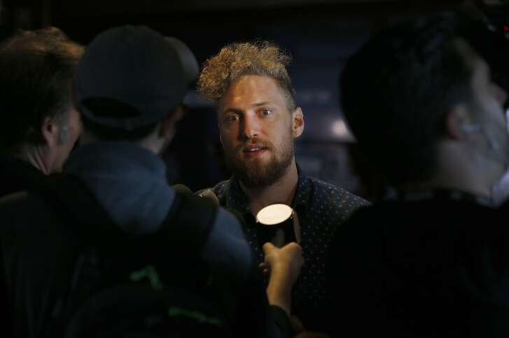 Outfielder Hunter Pence is interviewed by sports reporters at AT&T Park in San Francisco, Calif. on Friday, Feb. 12, 2016, in advance of the Giants' annual FanFest event.
