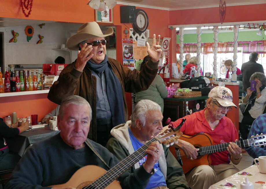 "Mario Fernandez sings ""Perfidia"" while accompanied by other musicians gathered to play Mexican romantic ballads, rancheras and boleros at Flor de Chiapas restaurant on the West Side. Photo: Billy Calzada / San Antonio Express-News / San Antonio Express-News"