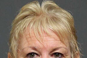 Woman charged with threatening roommate - Photo