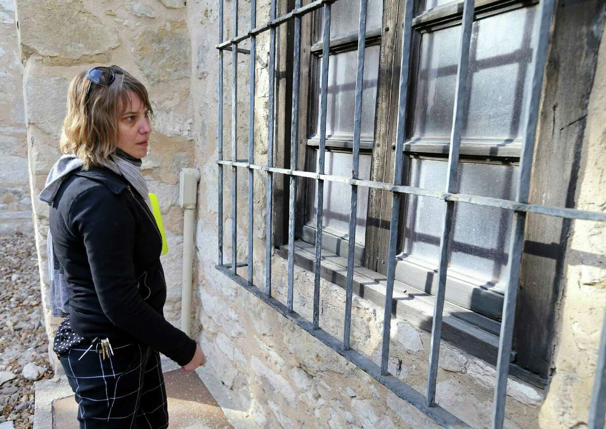 2. Windows of the Alamo Church and long barrack will be repaired or replaced. Kim Barker, construction project manager at the Alamo, shows a window section to be repaired in the Alamo complex Monday Feb. 8, 2016.