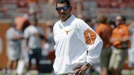Texas offensive coordinator Jay Norvell watches over his players before the game against Oklahoma State on Sept. 26, 2015, in Austin.