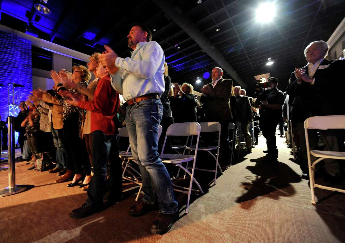 """Ronald W. Erdrich/Reporter-News Audience members applaud U.S. Senator and Republican presidential candidate Ted Cruz during a rally Tuesday night, Dec. 29, 2015 in Cisco. The """"Reigniting the Promise Community Rally"""" was sponsored by the Keep the Promise Super PAC and held at the Myrtle Wilks Community Center. At the edge of the third row stands Farris Wilks, whose mother the building is named after."""