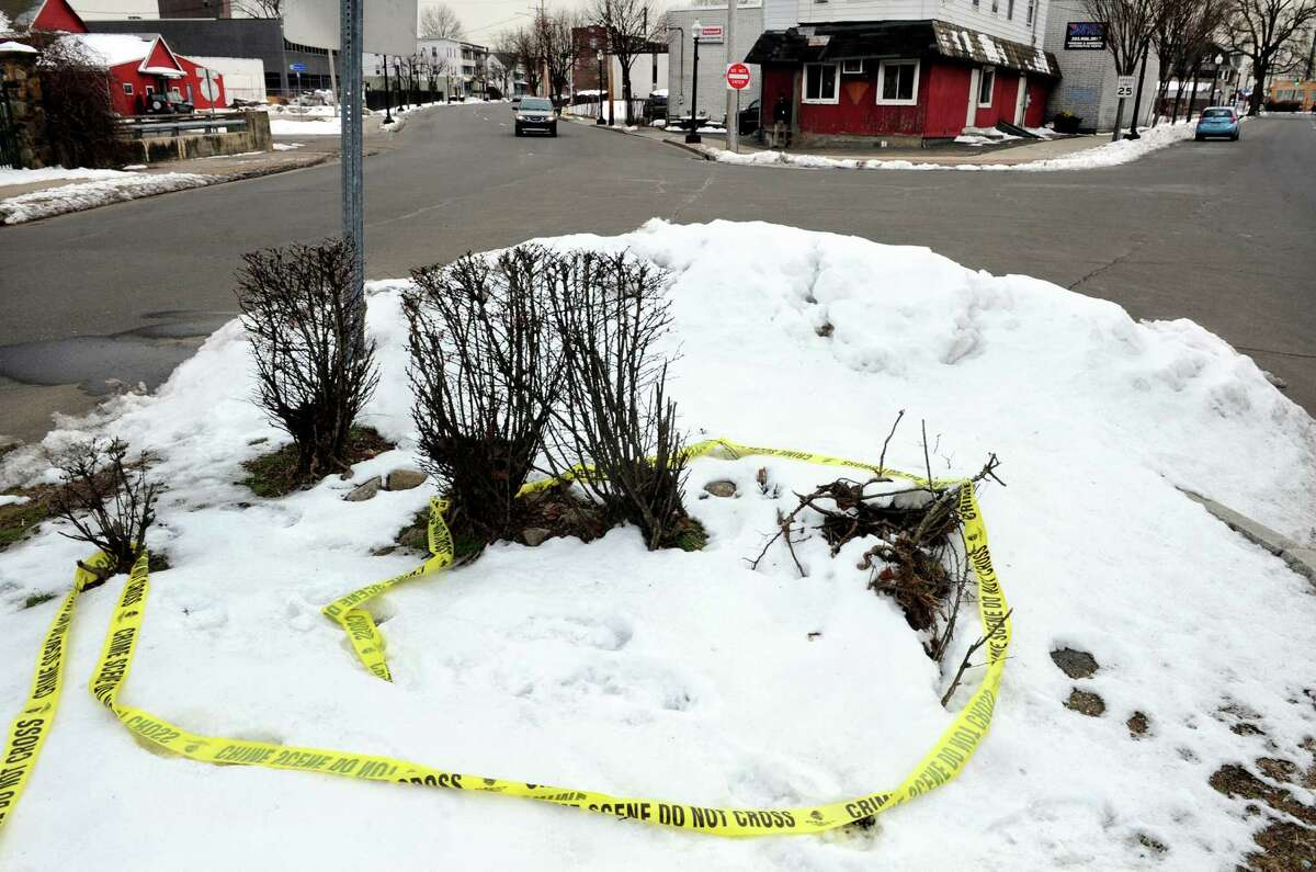 Crime scene tape lies on the ground near the spot where Javoni Patton was found after being shot at the corner of Connecticut and Stratford avenues in Bridgeport.