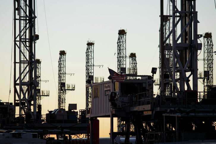 Oil rigs are stacked for storage near Midland. U.S. energy companies sidelined an additional 28 oil drilling rigs this week, extending the decline in the nation's oil rig count to 439, about 73 lower than its peak in October 2014, Baker Hughes said.