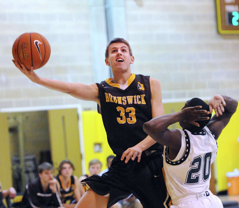 Brunswick's Raphael Ruban (#33), left, beats Hamden Hall's Kyle Williams (#20) to score during the boyshigh school basketball game between Brunswick School and Hamden Hall at Brunswick in Greenwich, Conn., Friday, Feb. 12, 2016. Brunswick defeated Hamden Hall by a score of 60-55. Photo: Bob Luckey Jr. / Hearst Connecticut Media / Greenwich Time