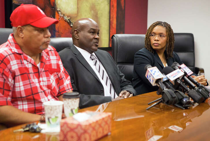 Donald Deason, left, Bruce Lawson, center, and attorney Shannon Baldwin, right, speak during a news conference on Aug. 8, 2014, in Houston after Mabrie Memorial Mortuary mixed up the deceased bodies of the two men's mothers. Edna L. Lawson passed away on July 19, 2014 and Pearlie Jean Deason on July 22, 2014.