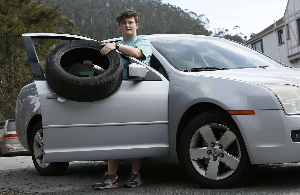 Elementary school teacher Liz Gustin was recently hit by a piece of concrete from the Yerba Buena tunnel which fell near the passenger side of her car while trying to avoid it in San Francisco, California. She shows a popped back tire and damages to the passenger side on Friday, February 12, 2016.
