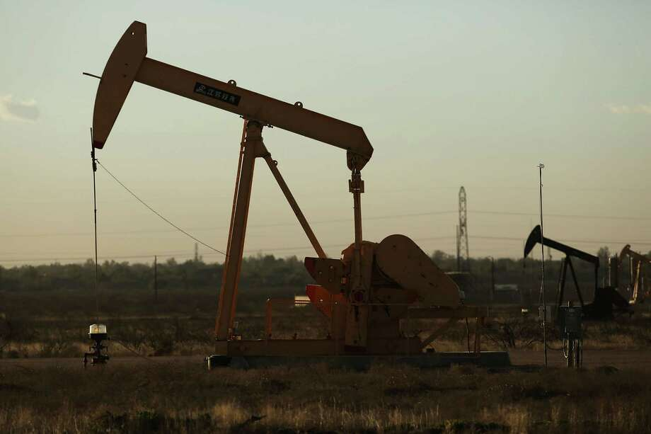 MIDLAND, TX - JANUARY 21:  A pumpjack sits on the outskirts of town  in the Permian Basin oil field on January 21, 2016 in the oil town of Midland, Texas. Despite recent drops in the price of oil, many residents of Andrews, and similar towns across the Permian, are trying to take the long view and stay optimistic. The Dow Jones industrial average plunged 540 points on Wednesday after crude oil plummeted another 7% and crashed below $27 a barrel.  (Photo by Spencer Platt/Getty Images) Photo: Spencer Platt, Staff / 2016 Getty Images