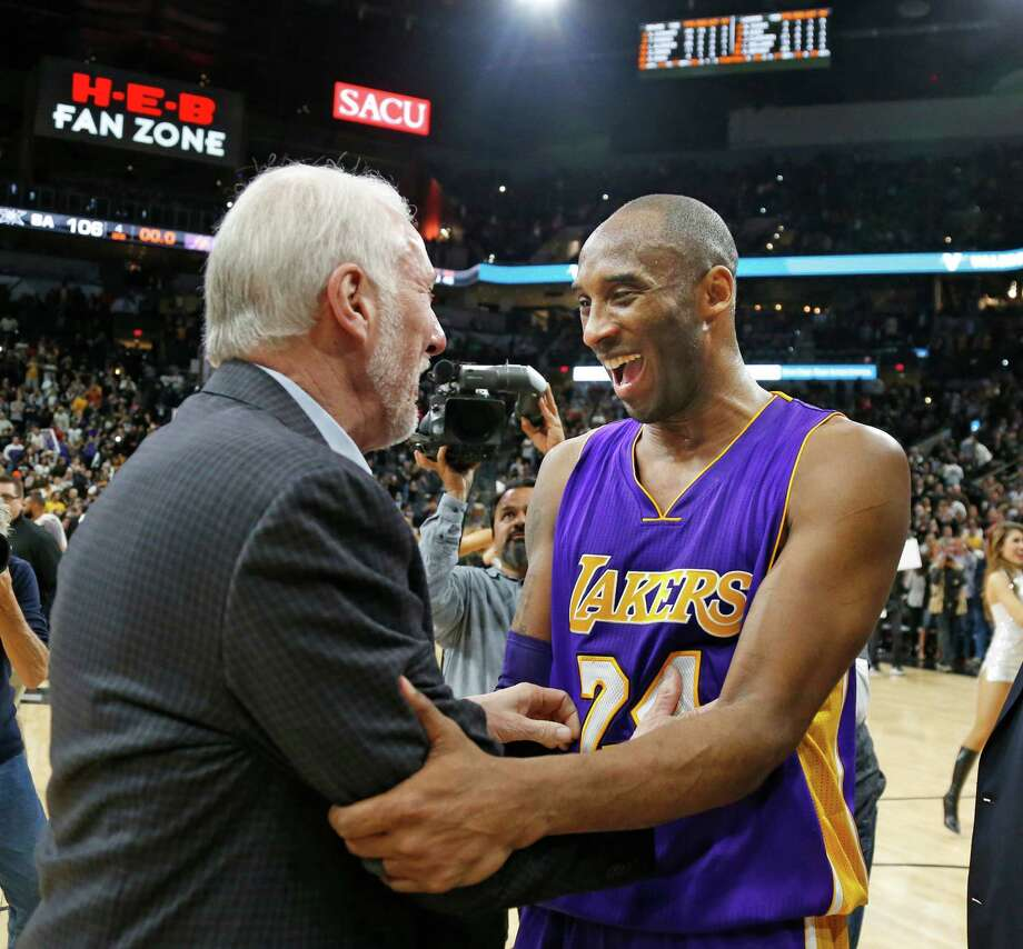 SAN ANTONIO,TX - FEBRUARY 6: Kobe Bryant #24 of the Los Angeles Lakers shares a light moment with San Antonio Spurs head coach Gregg Popovich at AT&T Center on February 6, 2016 in San Antonio, Texas.  NOTE TO USER: User expressly acknowledges and agrees that , by downloading and or using this photograph, User is consenting to the terms and conditions of the Getty Images License Agreement. (Photo by Ronald Cortes/Getty Images) Photo: Ronald Cortes, Stringer / Getty Images / 2016 Getty Images
