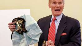 Sen. Bill Nelson, D-Fla. holds an example of the defective air bag made by Takata. According to documents posted Friday, Volkswagen resisted U.S. government efforts to recall Volkswagen vehicles to fix potentially deadly Takata air bags, telling safety regulators that a recall isn't necessary.