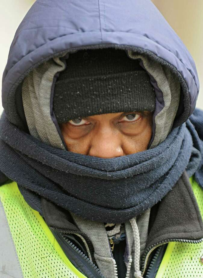 Crossing guard Gregory McPhaul of Albany is bundled up for the cold weather as he heads to the corner of Madison Ave. and Lark St. to help children cross the intersection on  Friday, Feb. 12, 2016 in Albany, N.Y.  (Lori Van Buren / Times Union) Photo: Lori Van Buren / 10035406A