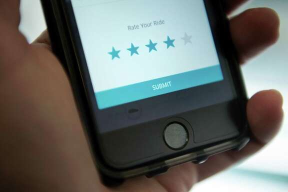 The driver rating screen in an Uber app is seen. Uber says the app shares a significant amount of driver information with riders.