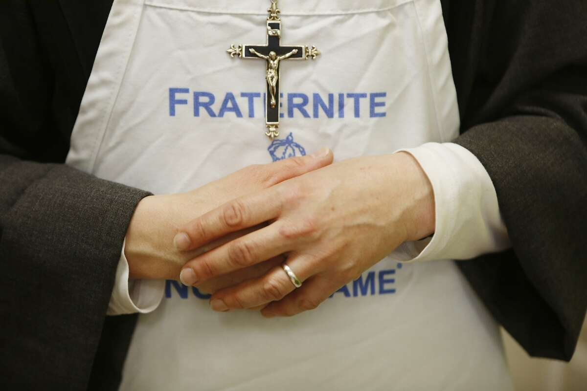 Sister Mary Valerie wears an apron with Fraternite Notre Dame on it at Fraternite Notre Dame Mary of Nazareth Soup Kitchen on Thursday, February 11, 2016 in San Francisco, Calif.