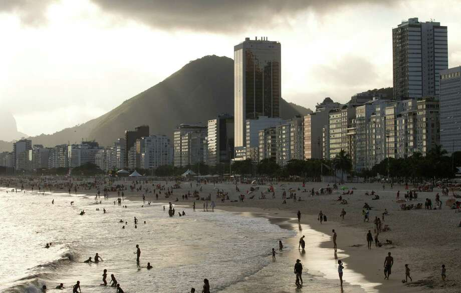 "FILE - In this Dec. 26, 2013, file photo, hotels and apartment buildings line the Copacabana beach shore in Rio de Janeiro, Brazil. The head of a sports travel agency specializing in packages for the Rio de Janeiro 2016 Olympics said that the company's business could be devastated if the Zika virus, or rumors about it, continue to spread. ""It could be catastrophic,"" according to Jerri Roush, executive vice-president of Cartan Tours. (AP Photo/Silvia Izquierdo, File) ORG XMIT: XSI201 Photo: Silvia Izquierdo / AP"