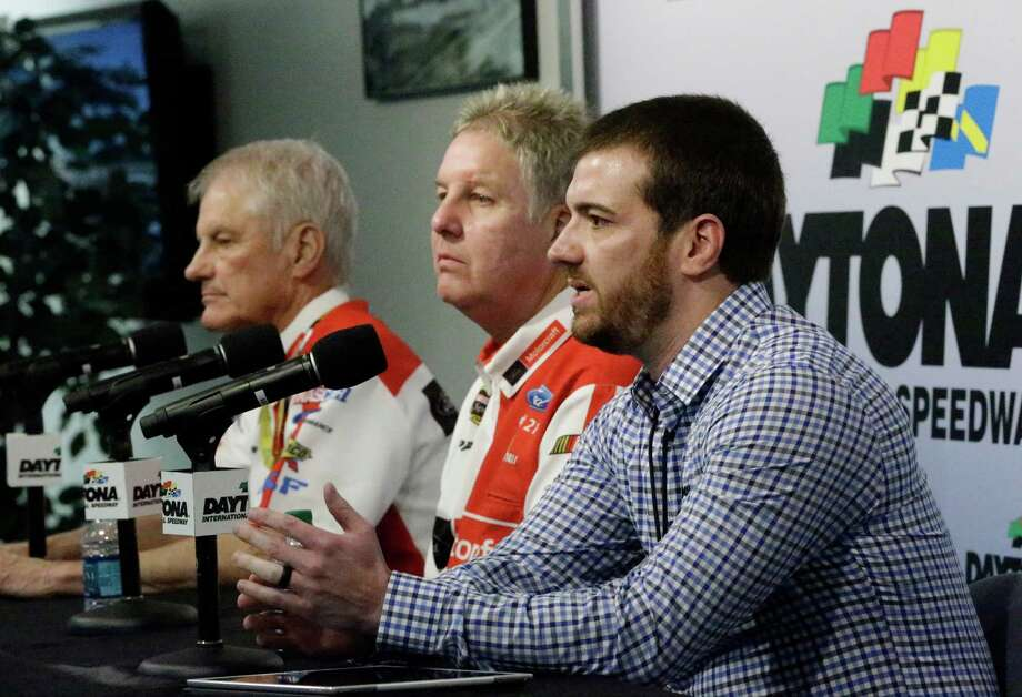 NASCAR auto racing team owners Eddie Wood, left, Len Wood, center, and Jon Wood, answer questions during a news conference at Daytona International Speedway, Friday, Feb. 12, 2016, in Daytona Beach, Fla.  (AP Photo/John Raoux)  ORG XMIT: DBR110 Photo: John Raoux / AP