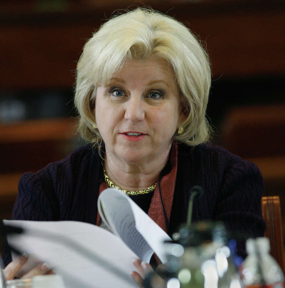 Sen. Jane Nelson, R-Lewisville, listens to testimony during a meeting of the Senate Committee on Health and Human Services, Thursday, March 22, 2007, in Austin, Texas. The committee, chaired by Nelson, discussed a new round of foster care reform measures amid the deaths of three young children in protective custody. (AP Photo/Harry Cabluck) Photo: Harry Cabluck, STF / AP