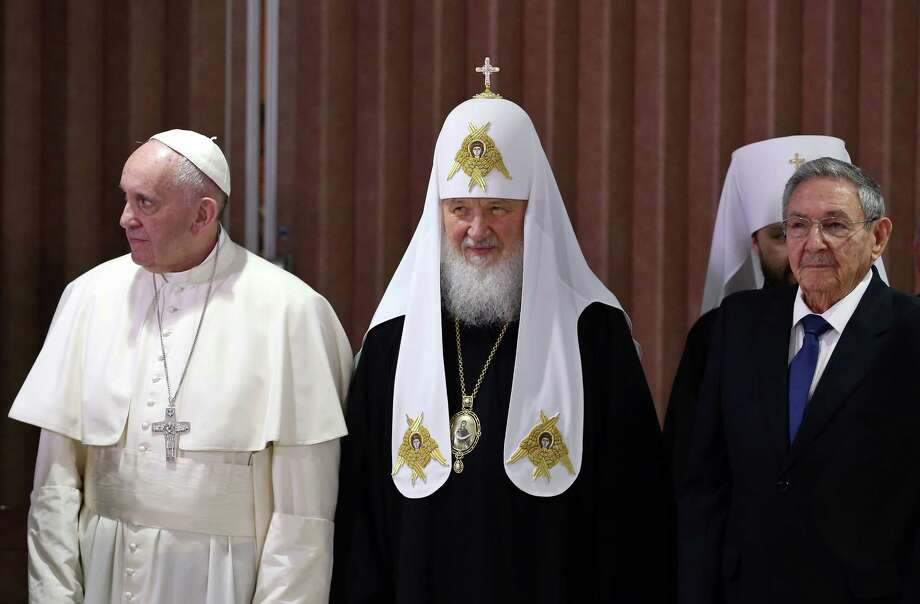 "Pope Francis, left, head of the Russian Orthodox Church Patriarch Kirill, center, and Cuba's President Raul Castro stand together during a document signing ceremony at Jose Marti airport in Havana, Cuba, Friday, Feb. 12, 2016. Francis and Kirill signed a joint declaration on religious unity. The declaration calls for peace in Syria, Iraq and Ukraine and urges Europe to ""maintain its faithfulness to its Christian roots."" (Alejandro Ernesto/Pool via AP) Photo: Alejandro Ernesto, POOL / EFE POOL"