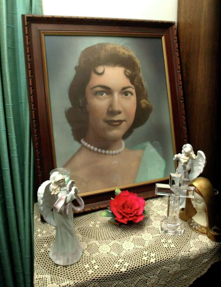Irene Garza, shown in a portrait in her aunt's home, was killed in 1960 at age 25.  A former priest was arrested Tuesday and charged in her death.