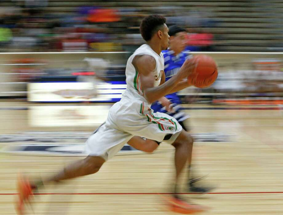 Sam Houston's Jawon Anderson pushes the ball down court against Lanier.  Slow shutter speed used to emphasize movement. Sam Houston-Lanier boys high school basketball game at Alamo Convocation Center on Friday, February 13, 3016. Photo: Ronald Cortes, Freelance / For Express News