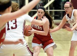 Mechanicville's Madison Harrington, center, weaves her way through Watervliet's defense during their Class B sectional basketball game on Friday, Feb. 12, 2016, at Watervliet High in Watervliet, N.Y. (Cindy Schultz / Times Union)