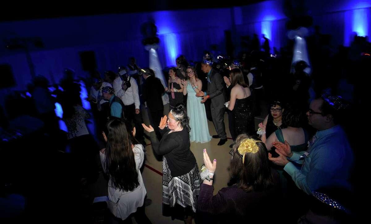 Prom-goers dance during the Faith Church