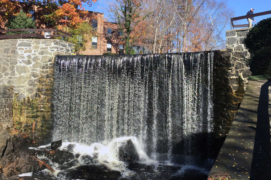 Water from the Byram River flows over the Mill Dam in  Greenwich, in a photo taken in November. Photo: Bob Luckey Jr. / Hearst Connecticut Media File Photo / Greenwich Time