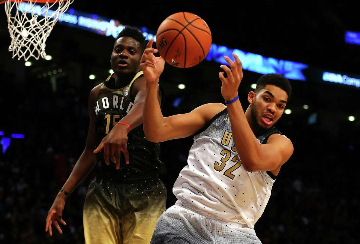 TORONTO, ON - FEBRUARY 12: Karl-Anthony Towns #32 of the Minnesota Timberwolves and the United States team competes for the ball with Clint Capela #15 of the Houston Rockets and World team in the second half during the BBVA Compass Rising Stars Challenge 2016 at Air Canada Centre on February 12, 2016 in Toronto, Canada. NOTE TO USER: User expressly acknowledges and agrees that, by downloading and/or using this Photograph, user is consenting to the terms and conditions of the Getty Images License Agreement.