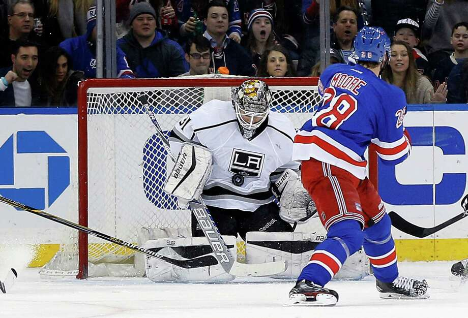 Los Angeles Kings goalie Peter Budaj (31) blocks a shot by New York Rangers center Dominic Moore (28) during the first period of an NHL hockey game Friday, Feb. 12, 2016, in New York. (AP Photo/Julie Jacobson) ORG XMIT: MSG109 Photo: Julie Jacobson / AP