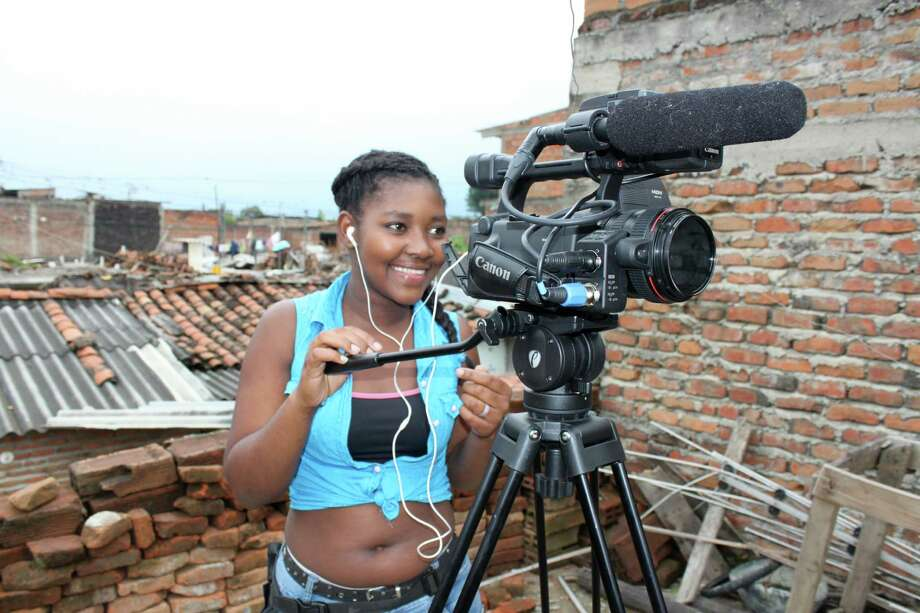 "María Ceballos Paz, a teenager in Colombia, making her film about being displaced by violence, ""Displaced, Not Defeated."" Photo: Contributed / Contributed Photo / Greenwich Time Contributed"