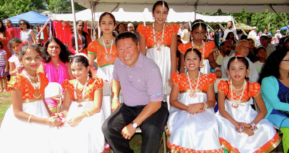 State Sen. Tony Hwang joined a troupe of young dancers in traditional Indian costumes at the 9th annual Heritage India Fest on Town Hall Green. Photo: Fairfield Citizen / File Photo / Fairfield Citizen