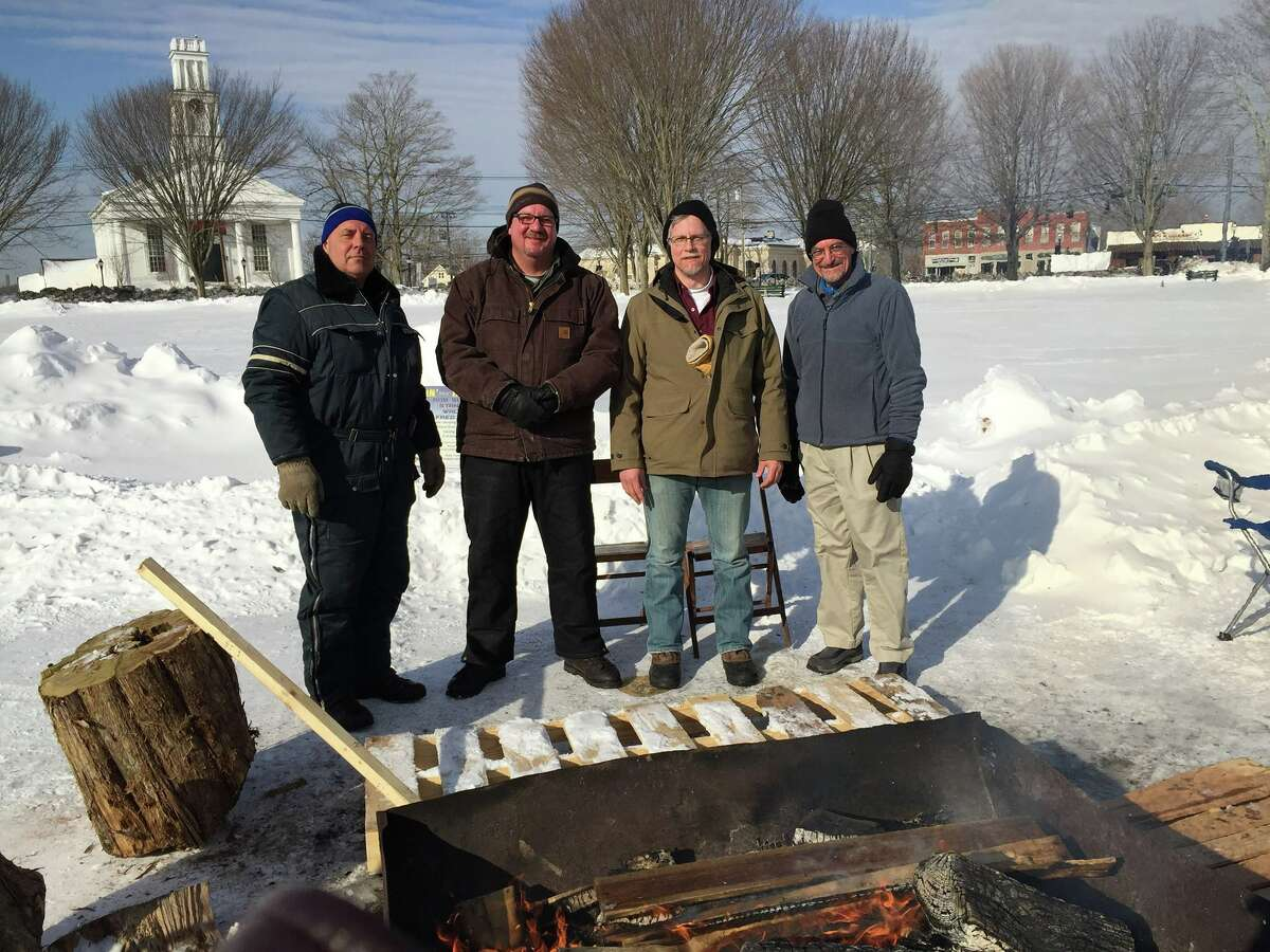 Colchester Police Officer Rob Sucheck, Stan Soby, Walt Cox and Fred Brown are Freezing for a Reason by camping on the Colchester Green in Eastern Connecticut. They're raising money for the Colchester Fuel Bank and are determined to stay there until Sunday, camping in tents with a roaring fire nearby.