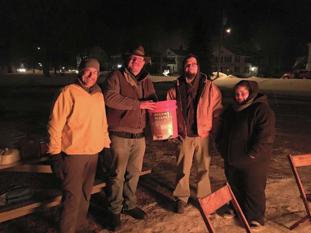 Members of the State Police resident trooper office in Colchester are camping out on the town green this weekend to raise money for the Colchester Fuel Bank. They got a donation from Seymour residents who drove there to make a donation.