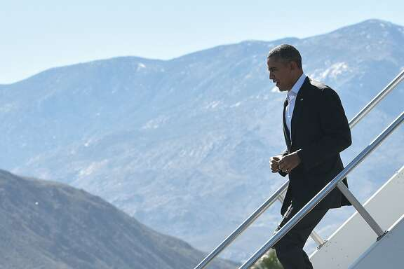 US President Barack Obama steps off Air Force One upon arrival at Palm Springs International Airport in Palm Springs, California on February 12, 2016. / AFP / MANDEL NGANMANDEL NGAN/AFP/Getty Images