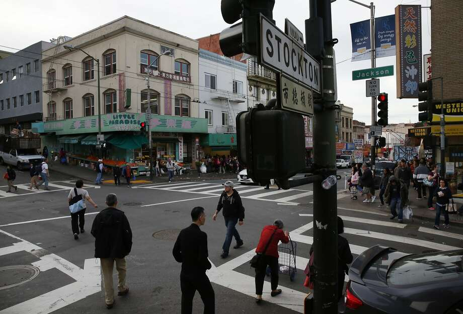 Pedestrians cross Jackson and Stockton Streets at a busy intersection in Chinatown Feb. 12, 2016 in San Francisco, Calif. Photo: Leah Millis, The Chronicle