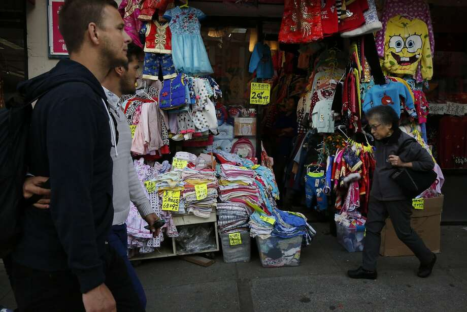People walk past a shop at the Far East Trade Center along Stockton Street in Chinatown Feb. 12, 2016 in San Francisco, Calif. Photo: Leah Millis, The Chronicle
