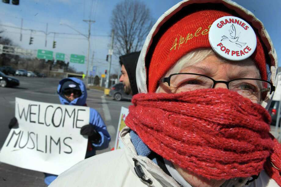 Dorothy Richards of Colonie joins other Grannies for Peace to spread love not hate as they brave the cold for a Valentine's Day Eve action at the corner of Central Avenue and Wolf Road on Saturday Feb. 13, 2016 in Colonie, N.Y.  (Michael P. Farrell/Times Union) Photo: Michael P. Farrell / 10035419A