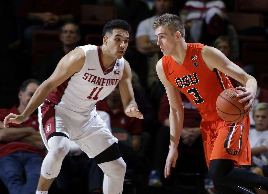 Oregon State forward Tres Tinkle (3) dribbles next to Stanford guard Dorian Pickens (11) during the second half of an NCAA college basketball game Thursday, Feb. 11, 2016, in Stanford, Calif. Oregon State won 62-50. (AP Photo/Marcio Jose Sanchez) Photo: Marcio Jose Sanchez, Associated Press