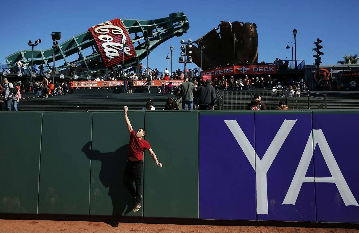 Edward Vaquerano catches a ball thrown by his friends in the outfield during the annual Giants Fan Fest at AT&T Park Saturday, Feb. 13, 2016 in San Francisco, Calif. Thousands of fans came to the park to see their favorite players, eat food, explore the field and the clubhouse.
