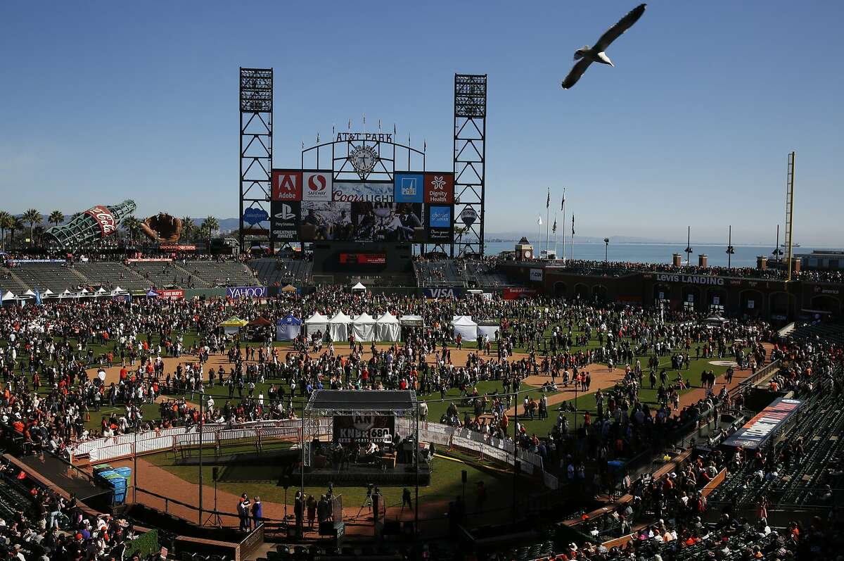 Thousands of fans mill around the field during the annual Giants Fan Fest at AT&T Park Saturday, Feb. 13, 2016 in San Francisco, Calif.