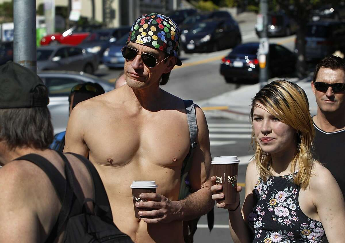 Lloyd Fishback, left, waits prior to the start of the first annual Valentine's Nude Parade put together by the Body Freedom Network, in San Francisco, Calif., on Saturday Feb. 13, 2016