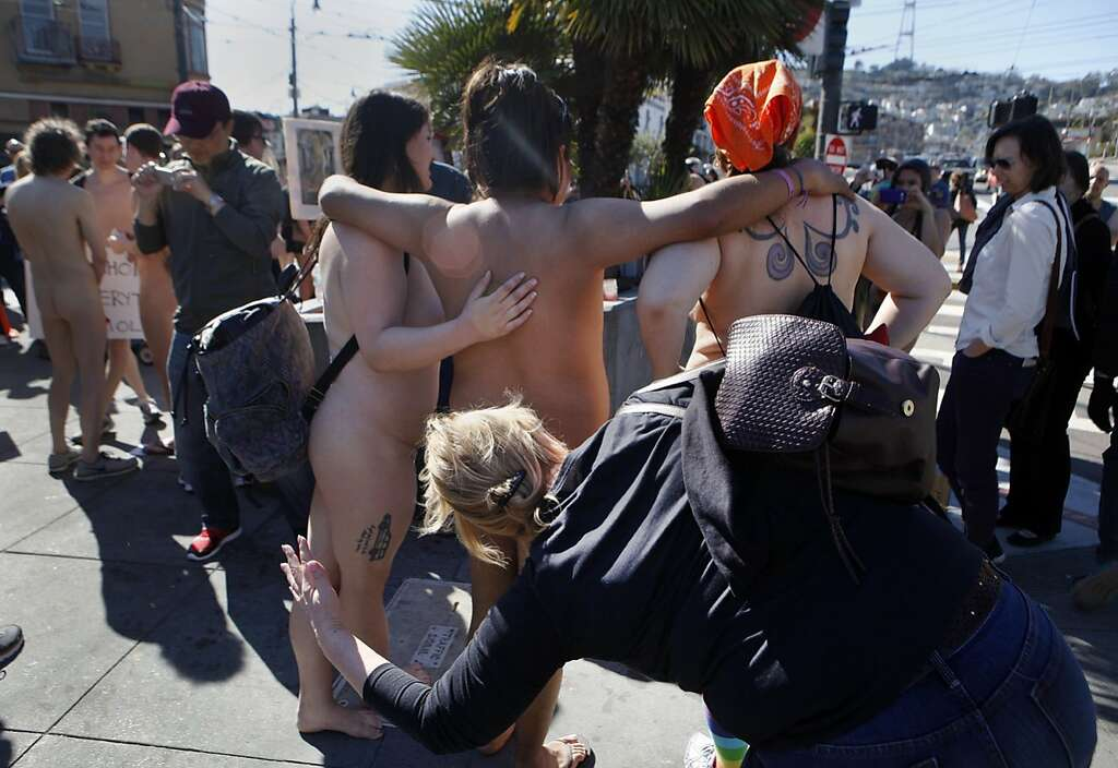 Participants of the first annual Valentine's Nude Parade put together by the Body Freedom Network, pose for pictures prior to the start of the walk in San Francisco, Calif., on Saturday Feb. 13, 2016 Photo: Brittany Murphy, The Chronicle