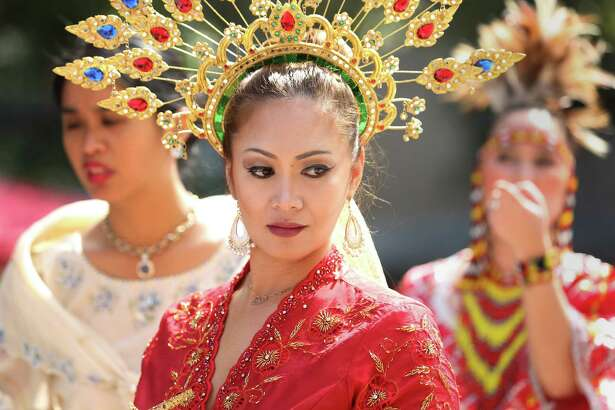 Abby Hamdan, center, waits backstage before performing with dancers from the Philippines Cultural Association at the Texas Lunar Festival at Hermann Square park Saturday, Feb. 13, 2016, in Houston.