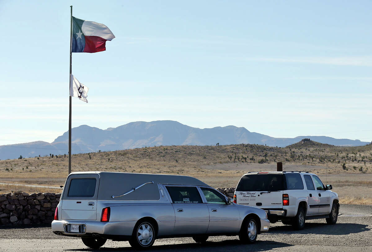 A man guards the entrance to Cibolo Creek Ranch Saturday Feb. 13, 2016 on U.S. 67 near Shafter, Tx.