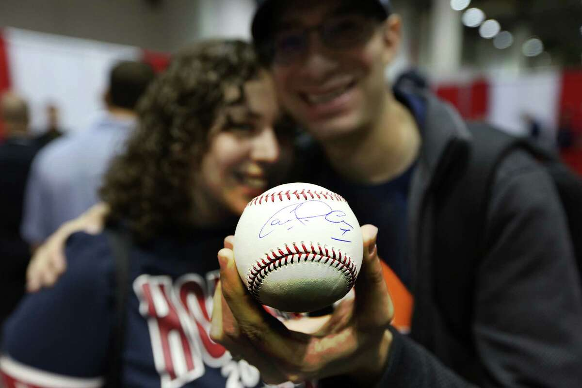 Fans Joel Gluskin & wife Talya Arbisser Gluskin show off the ball Carlos Correa signed. He saved that ball for 3 years and asked Astros shortstop Carlos Correa autograph it at the TriStar Show at NRG Arena Saturday, Feb. 13, 2016, in Houston.