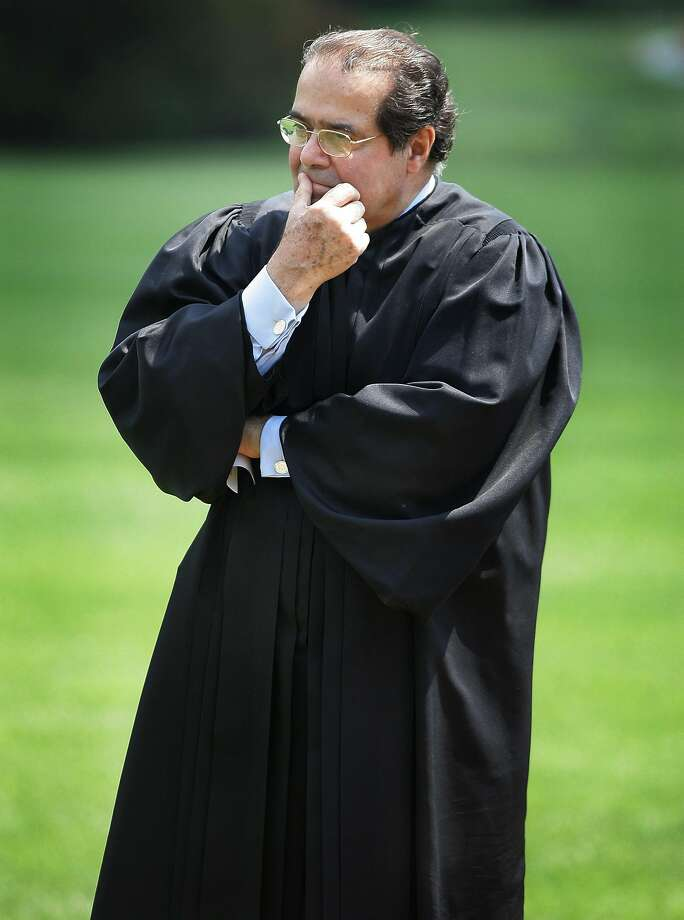 Supreme Court Justice Antonin Scalia listens to President George W. Bush speak during a 2006 event at the White House. He died Saturday at age 79. Photo: Ron Edmonds, Associated Press
