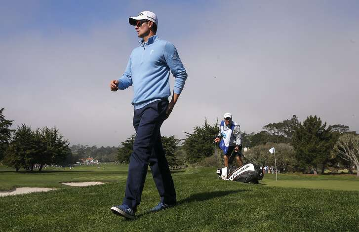 Justin Rose makes his way to the 3rd hole at the Pebble Beach Golf Links, during the third round of the AT&T Pebble Beach Pro-Am on Sat. February 13, 2016, in Pebble Beach, California.