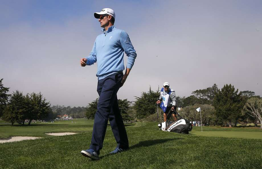 Justin Rose makes his way to the 3rd hole at the Pebble Beach Golf Links, during the third round of the AT&T Pebble Beach Pro-Am on Sat. February 13, 2016, in Pebble Beach, California. Photo: Michael Macor, The Chronicle