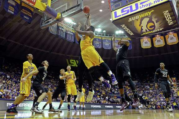 LSU forward Brian Bridgewater (20) puts the ball up for two points in the first half of an NCAA college basketball game against Texas A&M in Baton Rouge, La., Saturday, Feb. 13, 2016. LSU won 76-71. (AP Photo/Bill Feig)