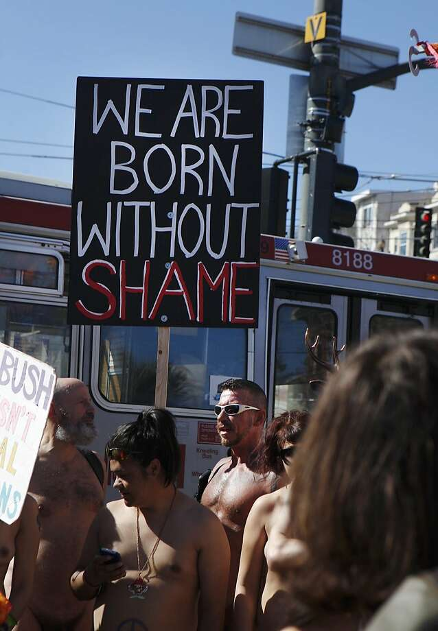 Ray Dalton holds a sign reading 'We Are Born Without Shame' during the first annual Valentine's Nude Parade put together by the Body Freedom Network, in San Francisco, Calif., on Saturday Feb. 13, 2016 Photo: Brittany Murphy, The Chronicle