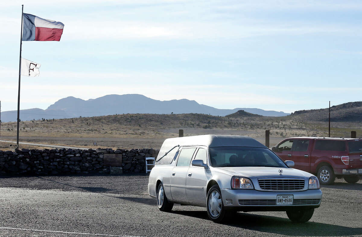 A hearse leaves the Cibolo Creek Ranch Saturday Feb. 13, 2016 on U.S. 67 near Shafter, Tx.